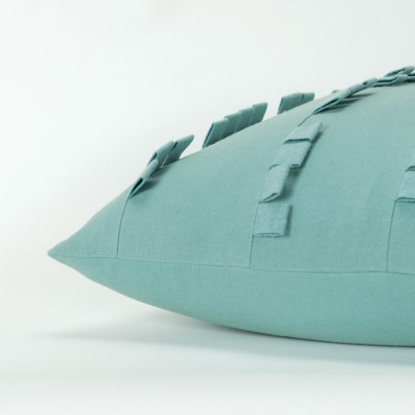 Side image of blue solid cotton, stitched panel throw pillow