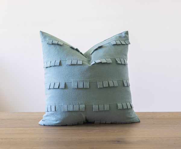 Avalon throw pillow in light blue with felted loop detail