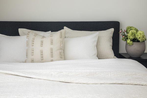 Neutral throw pillows that match cream bedding