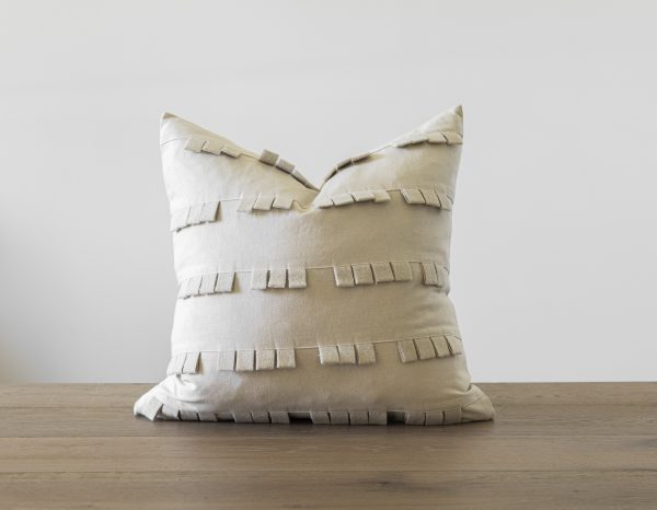 Decorative throw pillow with fringe detail