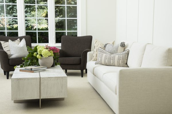 Relaxed living room design with decorative throw pillows from the Donny Osmond Home collection
