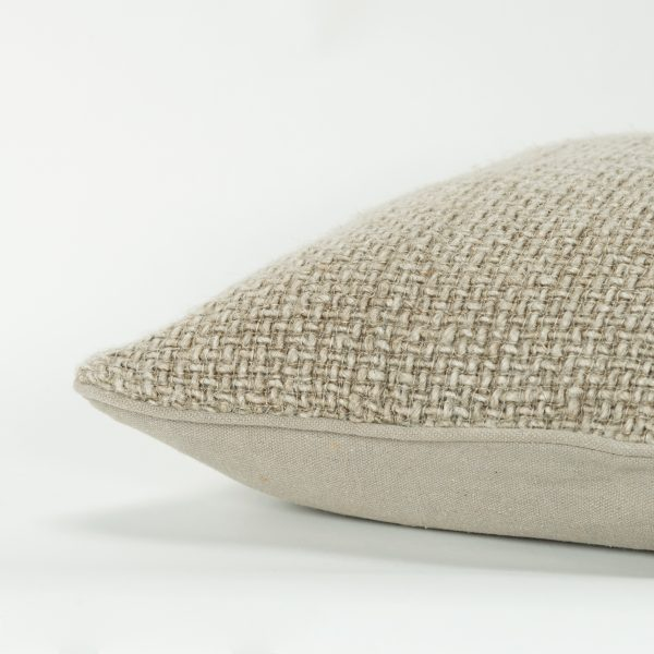 Side view of the Coronado tweed pillow with one textured side and one canvas side